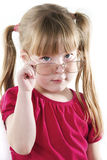 Clever girl holds in hand the eyeglasses Stock Photo
