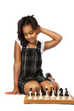 Clever  girl playing chess thinking Royalty Free Stock Photo