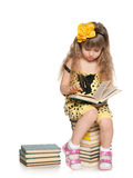 Clever girl reads on the pile of books Stock Images
