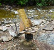 A clever home-made sluice set up beside a river in alaska Royalty Free Stock Photo