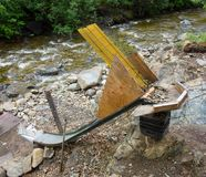 A clever home-made sluice set up beside a river in alaska Stock Photo