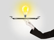 Clever idea concept with bulb on tray Stock Photography