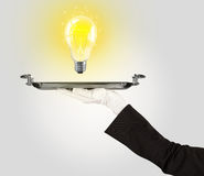 Clever idea concept with bulb on tray Stock Photo