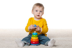 Clever infant boy with a toy Royalty Free Stock Photography