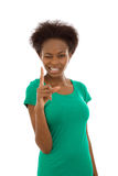 Clever isolated afro american girl looking serious with forefing Stock Photography