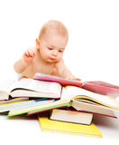 Clever kid. Reading a heap of different books royalty free stock images