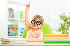 Clever kid child girl with books indoors. Portrait clever kid child girl with books indoors royalty free stock photo
