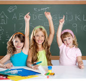 Clever kids student group at school classroom. Smart group of student kids at school classroom raising hand Stock Photo