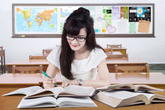 Clever learner studying in the classroom Stock Photo