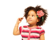 Clever little black girl. Thinking - portrait on white Stock Photo