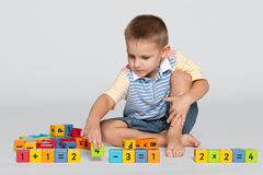 Clever little boy with blocks on the floor Stock Photography