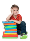 Clever little boy with books Royalty Free Stock Image
