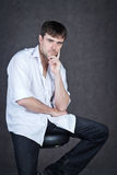 Clever man with a gray background Stock Images