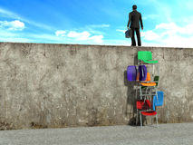 Clever man try solution to climb the wall.  Royalty Free Stock Photos