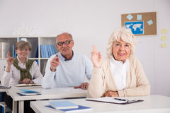 Clever mature students Stock Photo