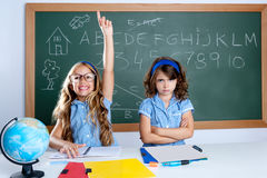 Clever nerd student girl in classroom raising hand Royalty Free Stock Photo