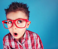 Clever nerdy boy. Surprised five years old boy wearing glasses Royalty Free Stock Image