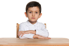 Clever little boy at the desk Royalty Free Stock Photos