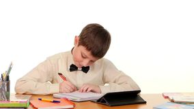 Clever school boy taught lessons using the tablet stock video