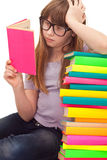 Clever school girl reading Stock Photo