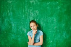 Clever schoolgirl Royalty Free Stock Images