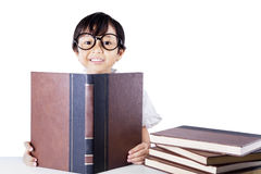 Clever schoolgirl reading books isolated Stock Photos
