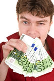 Clever strong man with money. Stock Photo