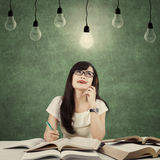 Clever student get inspiration under light bulb Stock Image