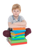 Clever young boy with books Royalty Free Stock Photo