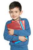 Clever young boy with books Stock Images