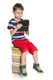 Clever young boy with a gadget Royalty Free Stock Image