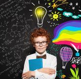 Clever young boy portrait. Brainstorming, creativity, science and arts occupations concept royalty free stock images