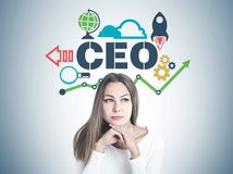 Clever young businesswoman thinking, CEO project. Head and shoulders portrait of a beautiful young woman with fair hair wearing white and thinking looking royalty free stock image