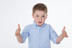 Clever young child on white background. Male kid shows the measure of something Stock Photo