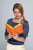 Clever young girl with a book Royalty Free Stock Image
