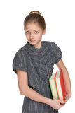 Clever young girl with books Stock Photos