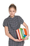Clever young girl holds books Stock Photography