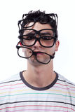 Clever young man. Young man full of eye glasses on his head (isolated on white royalty free stock photography