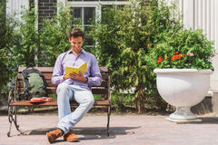 Clever young man studying outdoors Stock Image