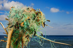 Clew. Tangled fishing nets on the sea shore Stock Image