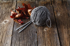 Clew of gray homemade wool yarn with needle Stock Photos