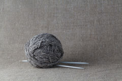 Clew of gray yarn with needle Royalty Free Stock Image