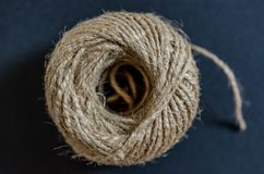 Clew of rope. Close up shot of a clew of rope on dark grey background Royalty Free Stock Photos