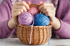 Clew of wool in basket Stock Image