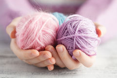 Clew of wool in woman hands Royalty Free Stock Photos