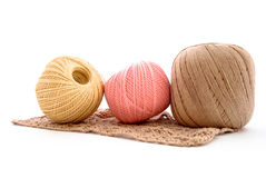 Clews. Three clews of different colors and crochet isolated on white Royalty Free Stock Photos