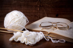 Clews with book and glasses Royalty Free Stock Photos