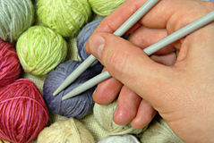 Clews and knitting needles. Clew and fingers plus knitting needles stock images