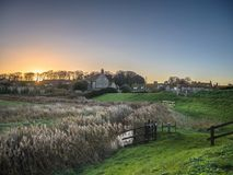 Cley Marshes at Sunrise. Cley next the Sea village stretches along the coast road where there are many access points onto the Norfolk Coast Path and Cley Marshes royalty free stock photography