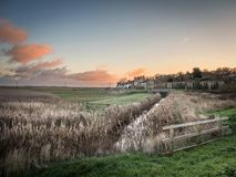 Cley Marshes at Sunrise. Cley next the Sea village stretches along the coast road where there are many access points onto the Norfolk Coast Path and Cley Marshes royalty free stock images